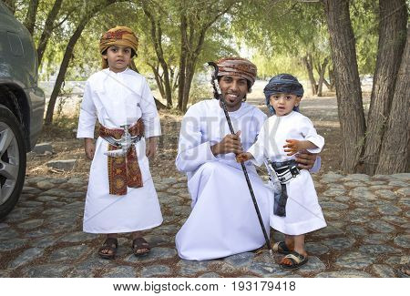 Nizwa Oman - June 26th 2017: omani family dressed for Eid al Fitr day that is celebrated at the end of Holy month of Ramadan