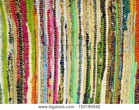close up view of colorful woven fabric strips