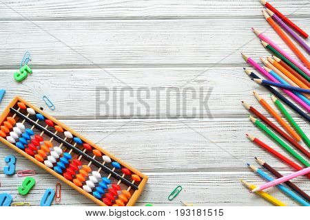 Colorful back to school supplies double border over white table. Mental arithmetic. Space for text. Flat lay style
