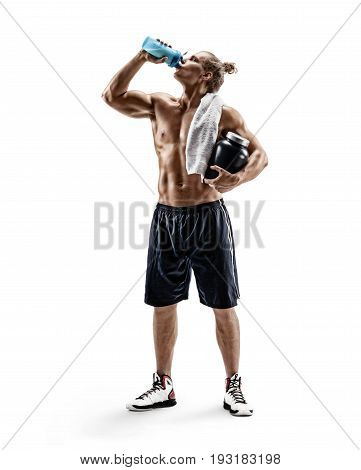 Resting time. Strong male with towel on shoulders drink protein cocktail of shaker. Photo of sportsman with large bank of sports nutrition isolated on white background. Full length. Health concept