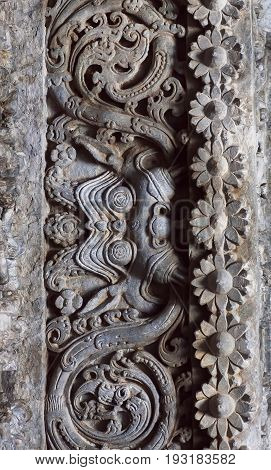 Background of carved patterns on historical walls of indian stone temple, India. Temple was built in 1150 in Karnataka state.