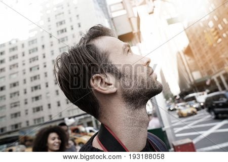 Portrait of man looking at New York city skyscrappers