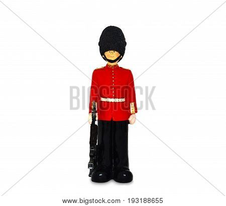 Queen's guard statue in traditional uniform with weapon, British soldier, isolated on white background, clipping path