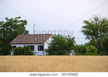 House on a bank of a chanel in Rovigo, Italy
