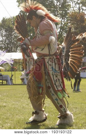 SMITHS FALLS ON JUNE 10 2017 EDITORIAL IMAGE SERIES OF NATIVES POWWOW CEREMONY with this image focused on an adult male native during the music and dance.