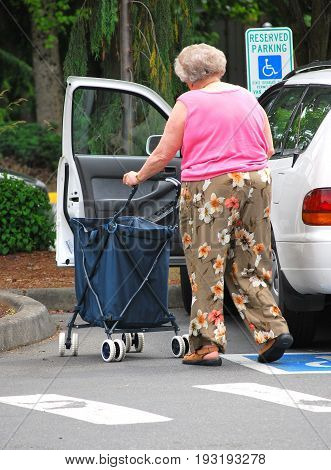 JUNE 14, 2008. SEATTLE, WA. CIRCA: Mature female senior parked in a disable parking stall for the handicap.