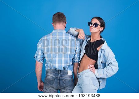 Fashionable Couple Of Denim Woman And Man In Glasses