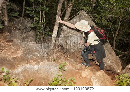 Pretty Asian woman hiking and climbing in mountains adventure and trekking.