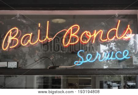 A neon Bail Bond sign in window