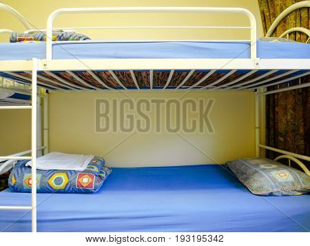 Bunk beds with pillows and blankets at the hostel