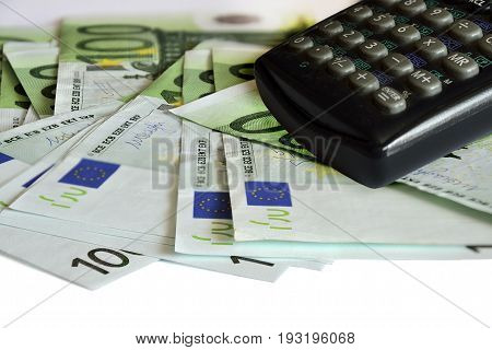 Euro money. A lot of Euro bills and calculator close up. Concept of economy saving and multiplying wealth