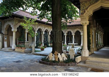 Bucharest, Romania - August 20, 2014: Inside yard of Stavropoleos Monastery in Bucharest, Romania. Situated downtown on Lipscani Street was built in 1724. The name Stavropoleos means