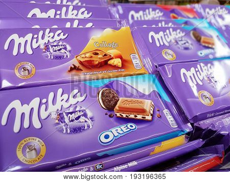 Nowy Sacz Poland - June 25 2017: Milka chocolate on store shelves for sale in a Tesco Hypermarket. Milka is a Swiss brand of chocolate confection.