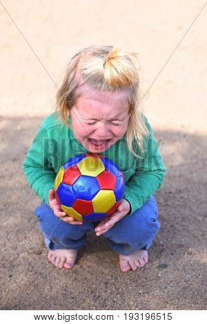Boy Little Adorable Kid Crying Sitting With Ball