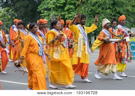 KOLKATA WEST BENGAL / INDIA - AUGUST 15TH 2016 : Bauls the local music mistrels of Bengal marching past in India's Independence day rally with musical instruments in their hands. A joyful day for all of them.