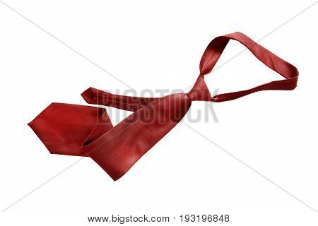 Red silk crumpled necktie isolated over white