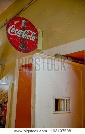 QUITO, ECUADOR - NOVEMBER 23, 2016: Informative sign indoor of the prison over a metal door in the old prison Penal Garcia Moreno in the city of Quito.