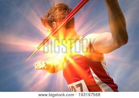 Male athlete holding javelin