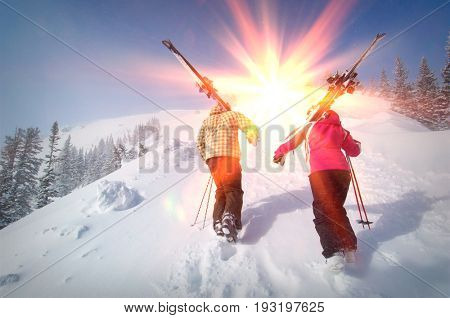Backcountry Skiers Hiking up a Slope