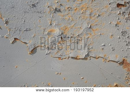 grey texture, surface of rusty iron with remnants of old paint, chipped paint, background