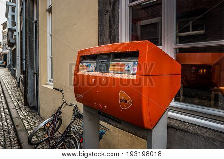 MAASTRICHT NETHERLANDS - JANUARY 16 2016: Orange mailbox postal service of the Netherlands.
