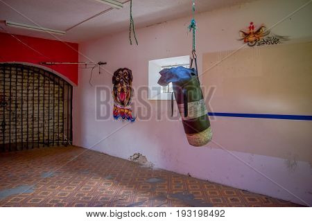 QUITO, ECUADOR - NOVEMBER 23, 2016: A sand bag inside of the old deserted rugged building, with some art in walls, in the old prison Penal Garcia Moreno in the city of Quito.
