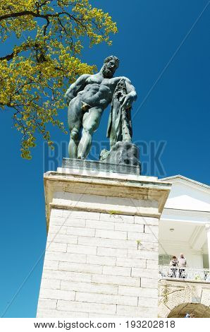 04.06.2017.Russia.Pushkin.Tsarskoye Selo.Statue of Hercules stands on a high pedestal in the city Park.