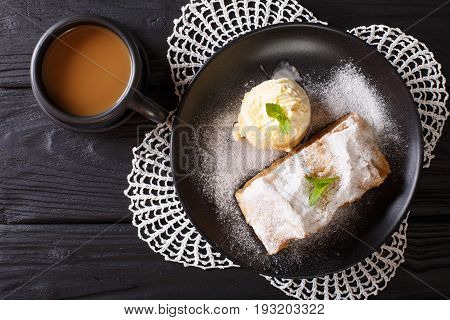 Apple Strudel With Vanilla Ice Cream On A Plate And Coffee With Milk Close-up. Horizontal Top View
