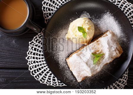 Austrian Apple Strudel With Vanilla Ice Cream And Coffee With Milk Close-up On The Table. Horizontal