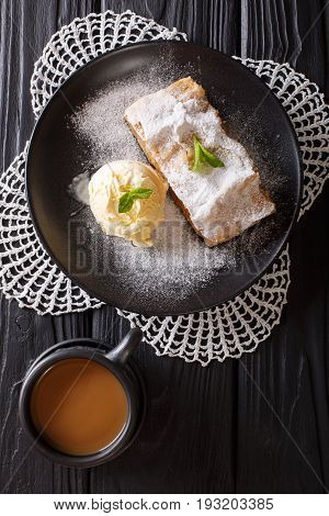 Apple Strudel With Vanilla Ice Cream On A Plate And Coffee With Milk Close-up. Vertical Top View