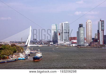 Rotterdam, Netherlands - May 12, 2017: Erasmus Bridge and harbor in Rotterdam, Netherlands