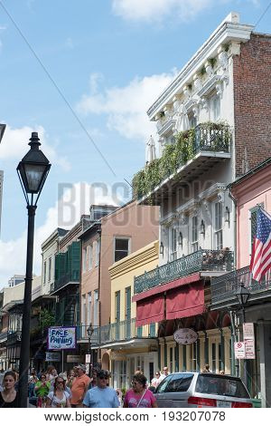 NEW ORLEANS, LA - APRIL 13: View of Street in the French Quarter of New Orleans, Louisiana showing historic buldings with unique architecture on April 13, 2014