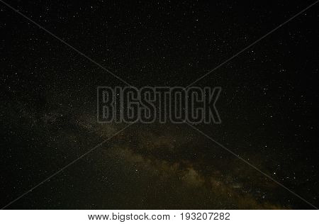 Night landscape with colorful Milky Way. Amazing summer Starry sky . Beautiful Universe. Space background