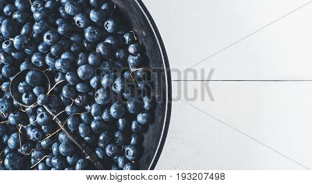 Blueberries on vintage wooden white background top view healthy food on dark table mockup berry for smoothie isolated on rustic vintage country board fresh bilberry copy space for text design
