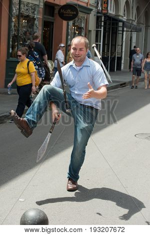 NEW ORLEANS, LA - APRIL 13: View of Juggler performs on street in New Orleans, LA on April 13, 2014