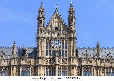 Palace of Westminster details London England. The Palace lies on the north bank of the River Thames in the City of Westminster in central London