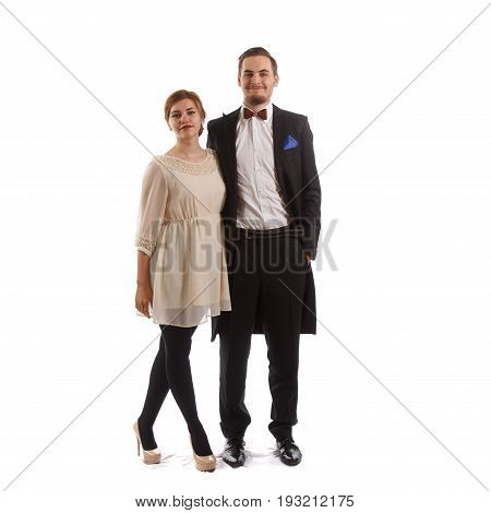 Young couple standing on a white background
