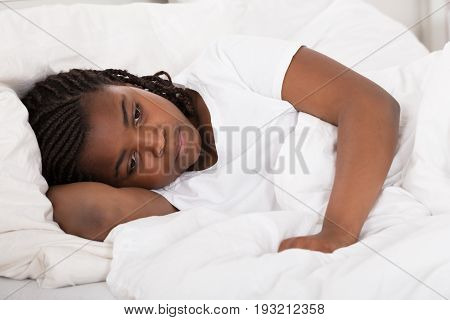 Girl Having Sleeplessness Night In Bed At Home