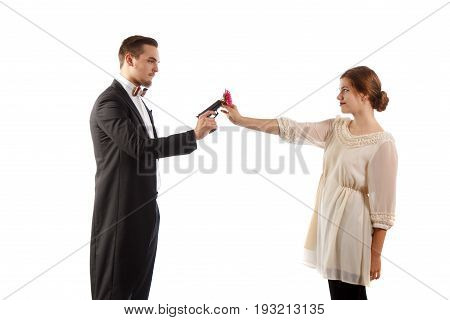 man with gun and women with flower standing on white background
