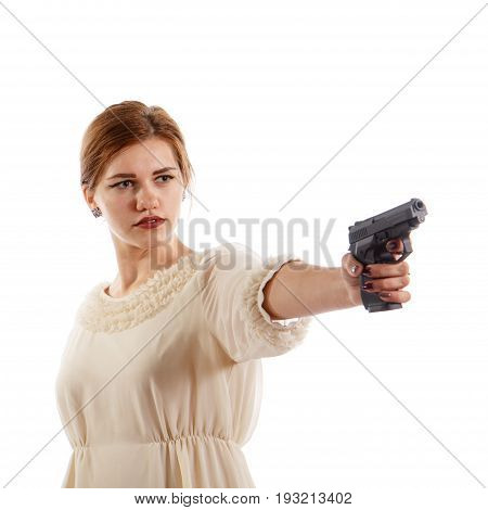 A young lady aiming a handgun on white background