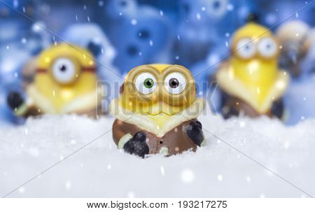 MAGNITOGORSK, RUSSIA - September 05, 2016: Toy minions in the artificial snow. Minions are the creatures that appear in the