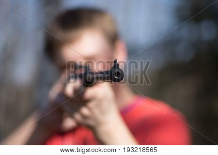 Man With Air Gun In Forest