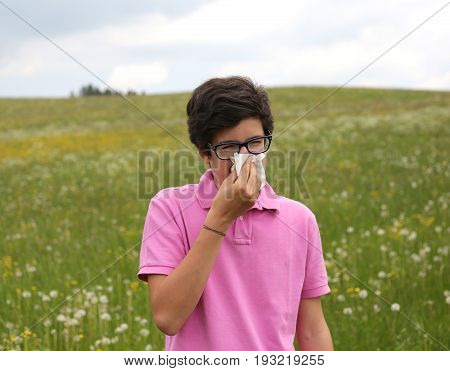 Allergic Caucasian Boy  Blows His Nose With A Handkerchief