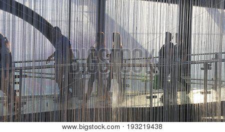 People Walk Back In The Metropolis Airport