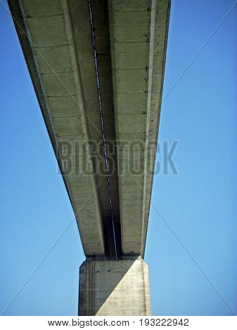 The Orwell Bridge in Suffolk crossing the River Orwell near Ipswich in the east of England. Shows that there are two road bridges separated by a narrow gap when viewed from underneath directly beneath the centre.