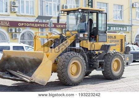NIZHNY NOVGOROD, RUSSIA June 28, 2017 : Auto appliances communal services of the city. Grader, a machine for collecting large debris from the roaad surface.NIZHNY NOVGOROD