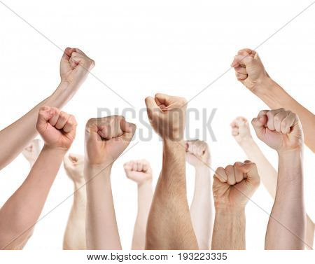 Raised human hands with clenched fists on white background. Strike and protest concept