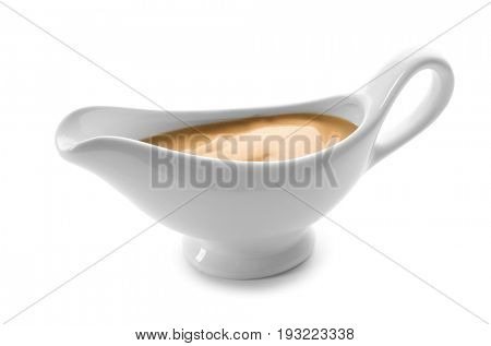 Sauce boat with turkey gravy on white background