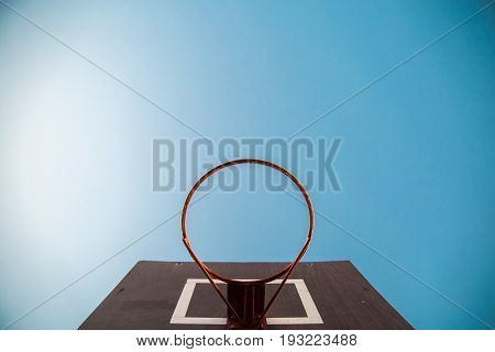 basketball hoop viewed from belowfocus on red zone