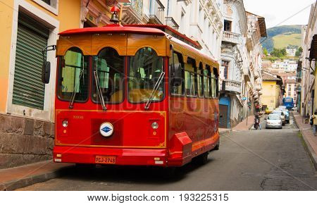 QUITO, ECUADOR - MAY 06 2016: Touristic bus at cobblestone street at panecillo hill in Quito, Ecuador.
